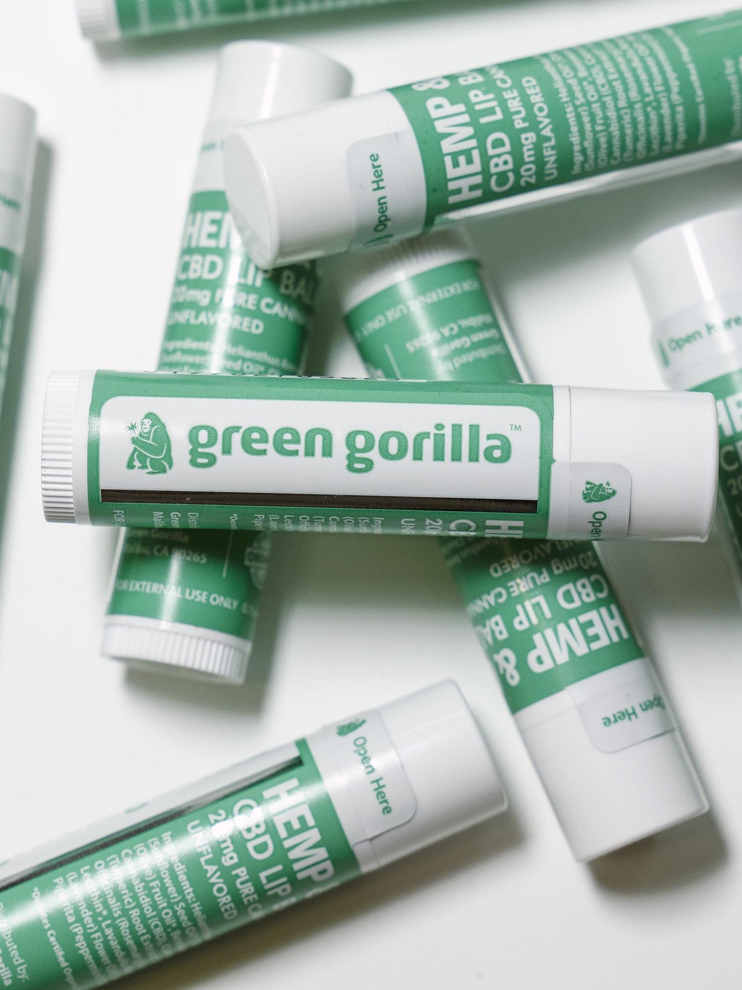 A pile of Green Gorilla™ CBD lip balm sticks