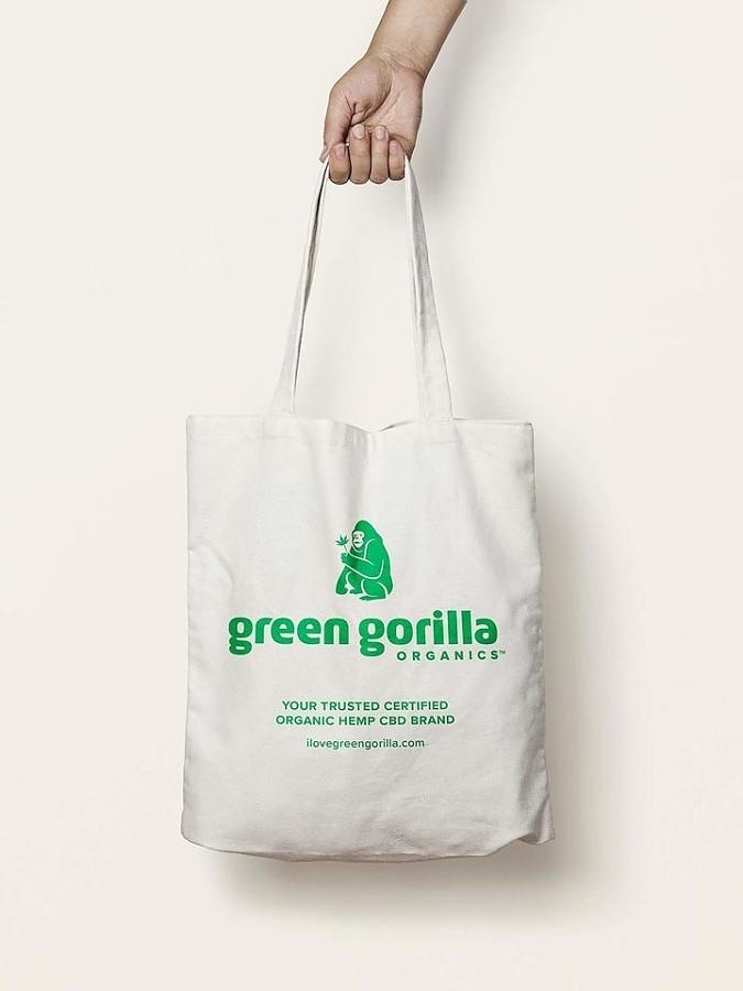 Person holding a Green Gorilla™ canvas tote bag.